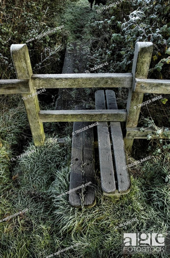 Stock Photo: A stile on a footpath with winter frost.