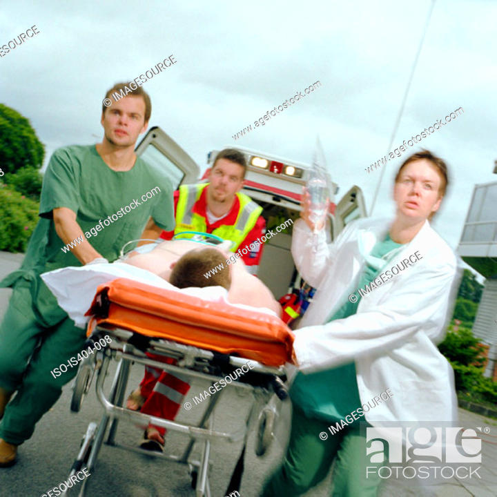 Stock Photo: Ambulance staff with patient.