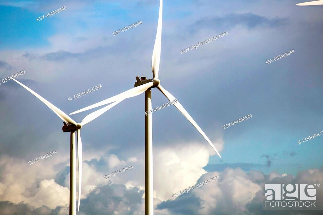 Photo de stock: modern windmill on a sunny day and with idyllic moody clouds, closeup of the foreground, Energy concept.