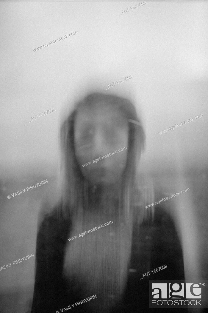 Stock Photo: Blurred motion of teenage girl against sky.