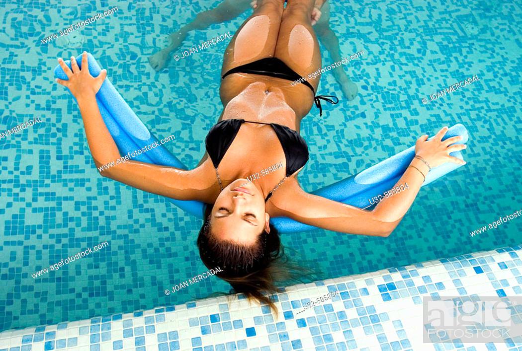 Stock Photo: Woman relaxing in indoor pool.