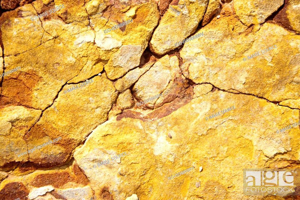 Stock Photo: Close up image of cracked rocks.