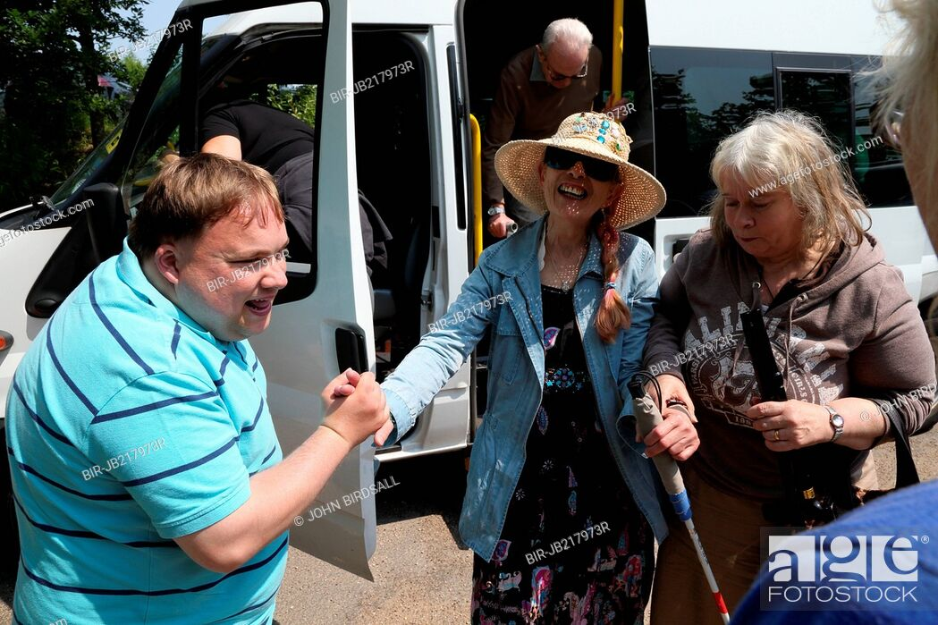 Stock Photo: People with visual impairments getting off a minibus.