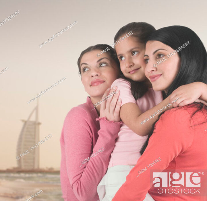 Stock Photo: Women and child on the beach in Dubai (with Burj Al Arab hotel in the background).