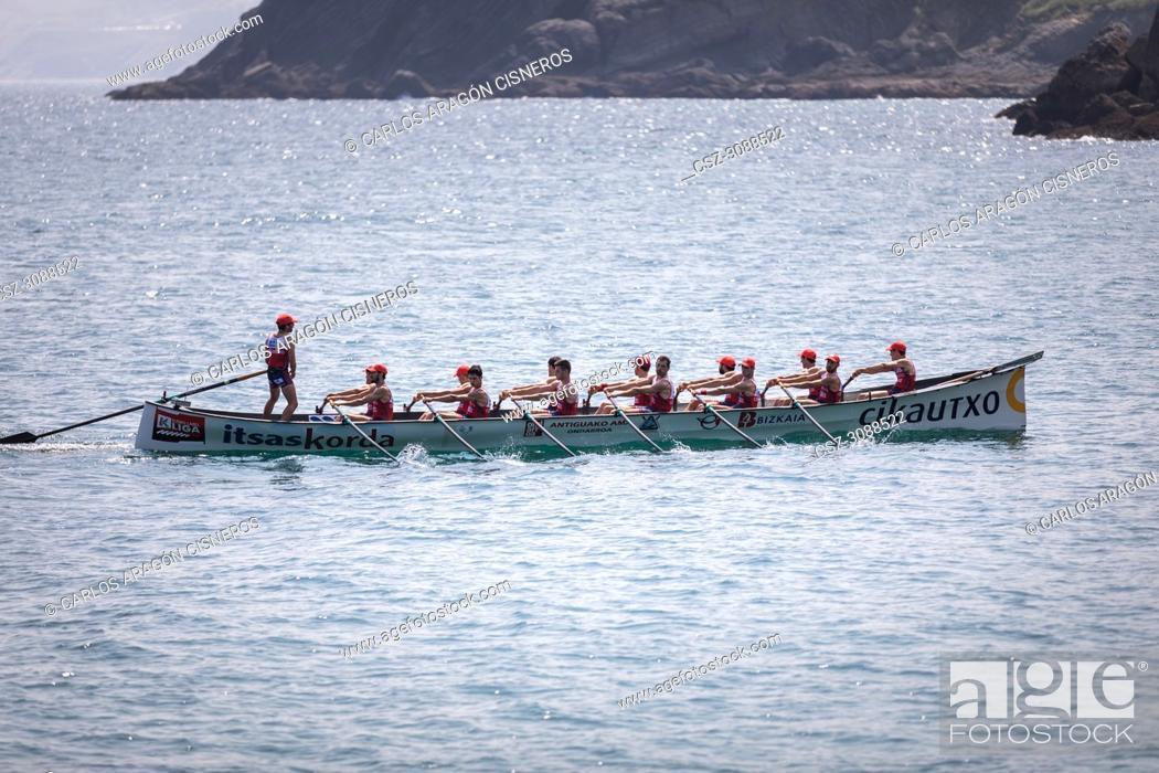 Stock Photo: CASTRO URDIALES, SPAIN - JULY 15, 2018: Competition of boats, regata of trainera, Ondarroa Cikautxo boat in action in the VI Bandera CaixaBank competition.