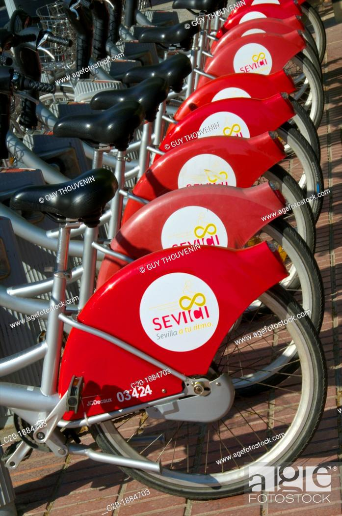 Stock Photo: Red Bikes for hire parking, , Seville, Andalusia, Spain.