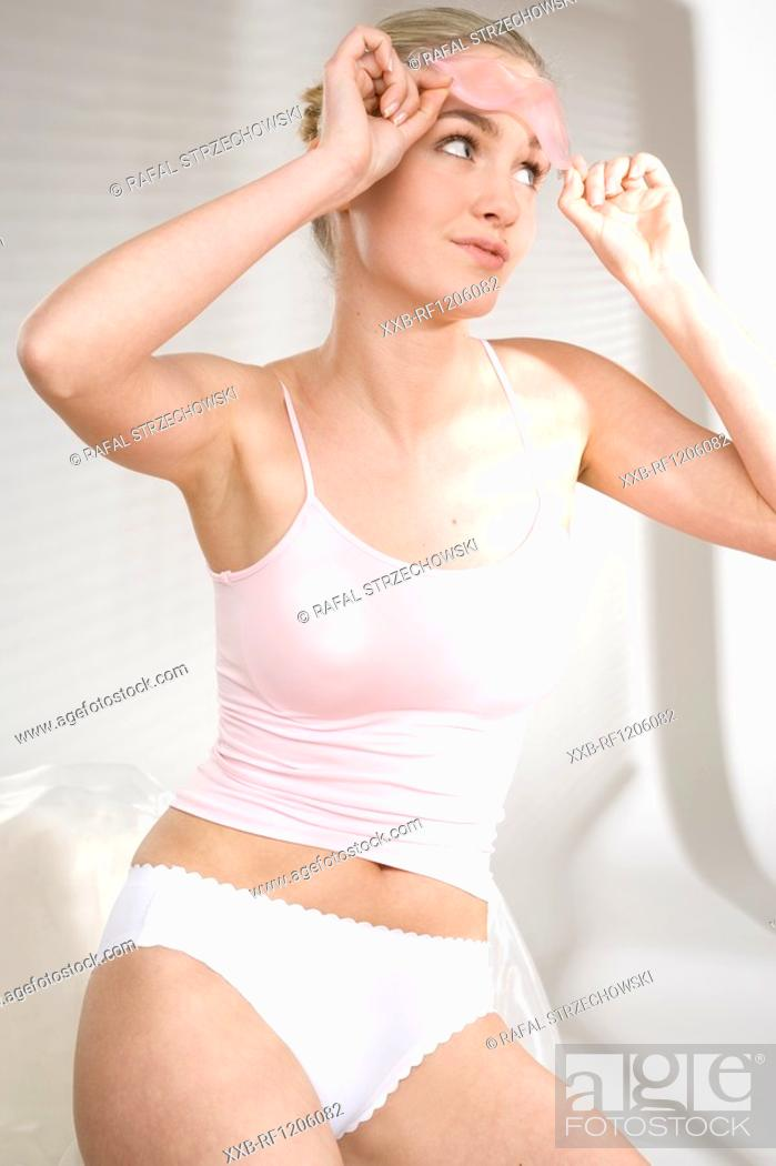 Stock Photo: young woman with eyeglasses mask.