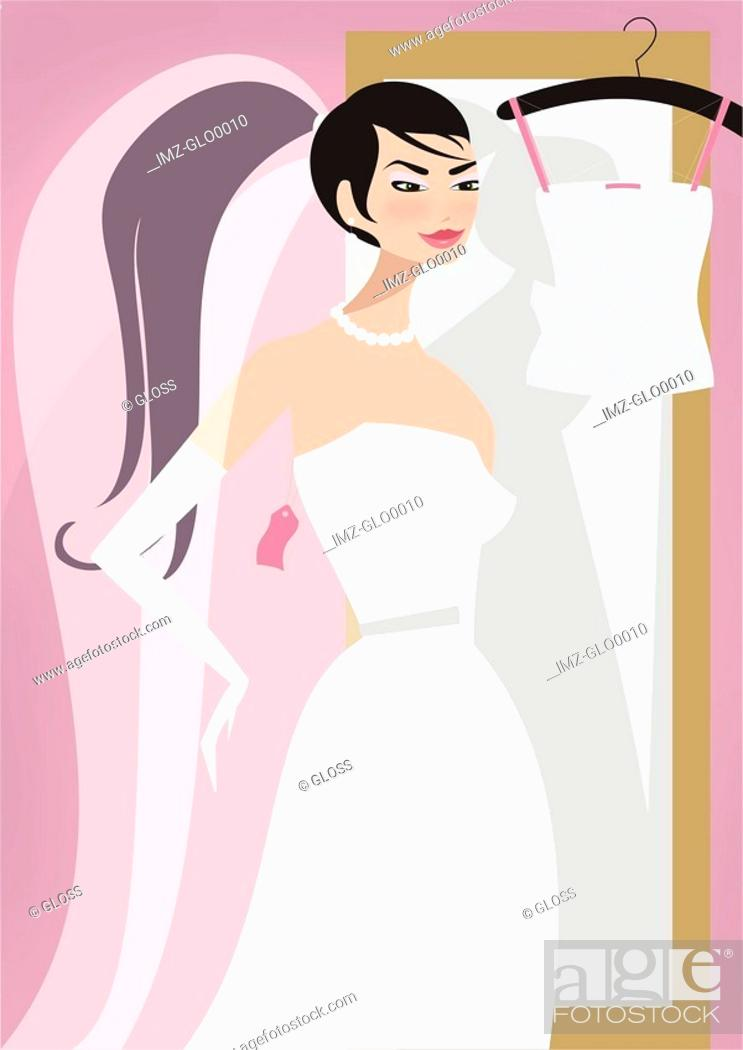 Stock Photo: A woman trying on bridal gowns.