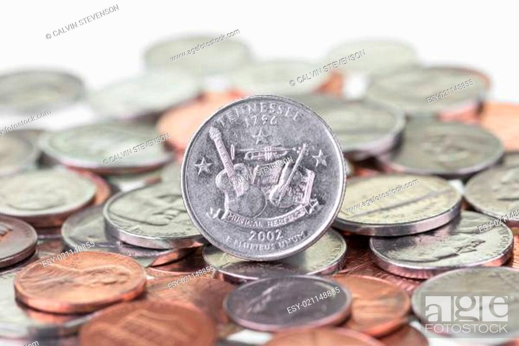 Stock Photo: 2002 Tennessee State Quarter with other coins extreme close up.