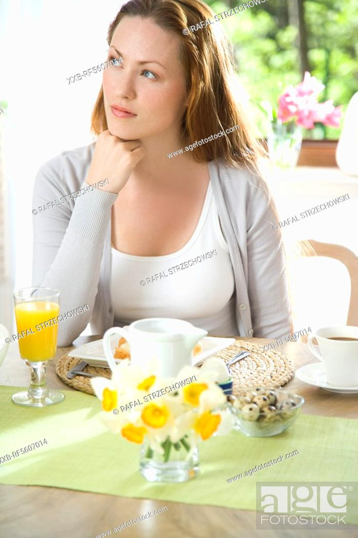 Stock Photo: woman eating breakfast.