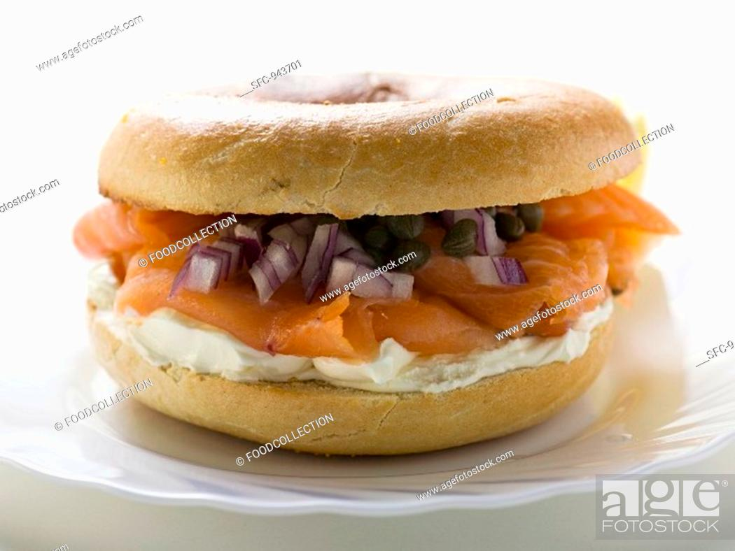 Stock Photo: Salmon, cream cheese, onions and capers in a bagel.