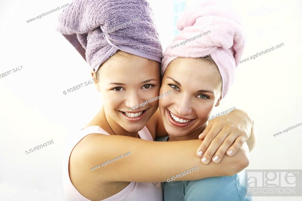 Stock Photo: Two girlfriends in a bathroom together.