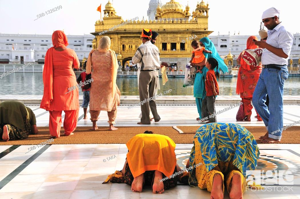 Stock Photo: People pray for the God in Golden Temple complex, Punjab Amritsar India.
