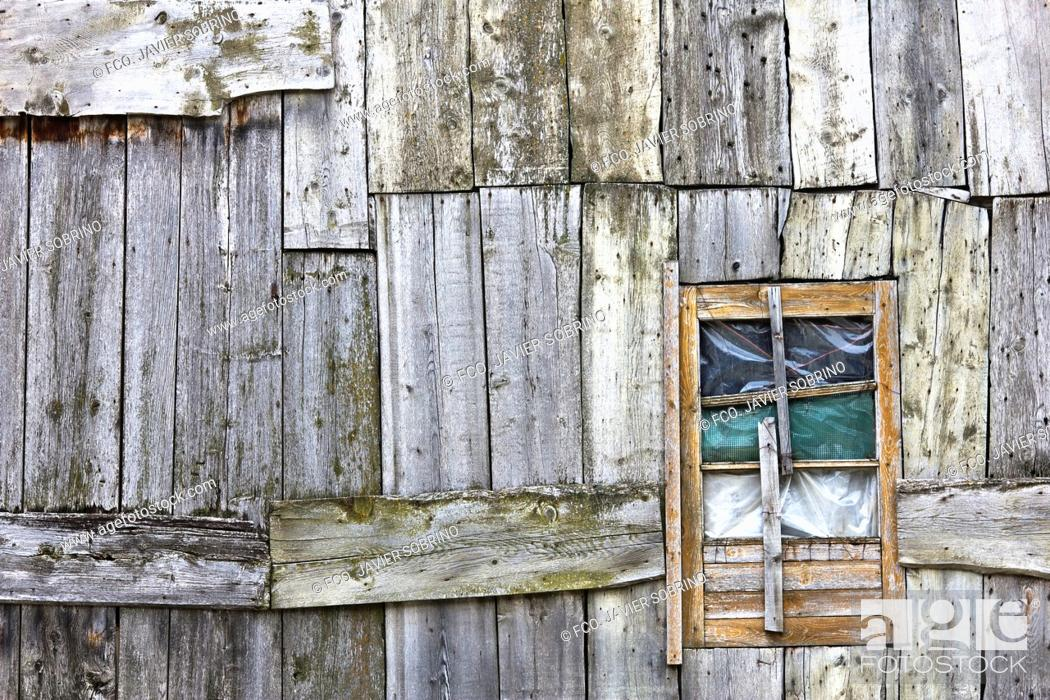 Stock Photo: Facade with windows and wooden planks in a house Taüll - Valle de Boi - Pyrenees - Lleida Province - Catalonia - Cataluña - Spain.