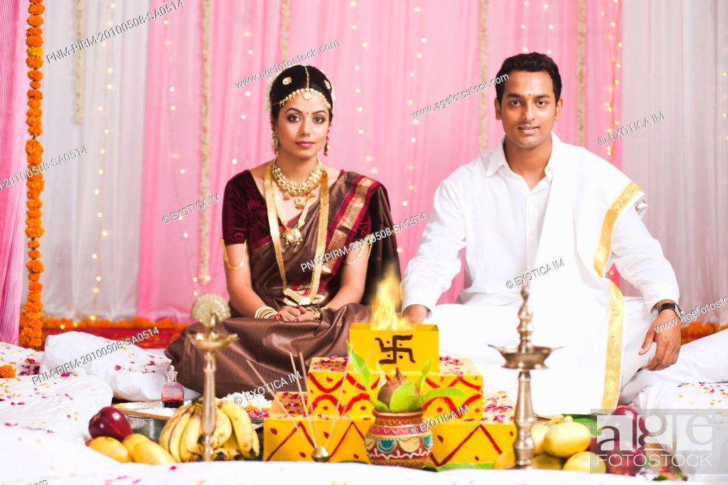 Bride And Bridegroom Sitting Near A Havan Kund At The Wedding Mandap