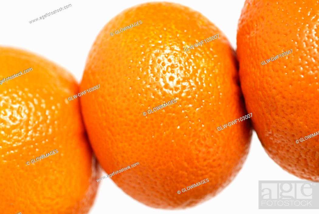 Stock Photo: Close-up of three oranges.