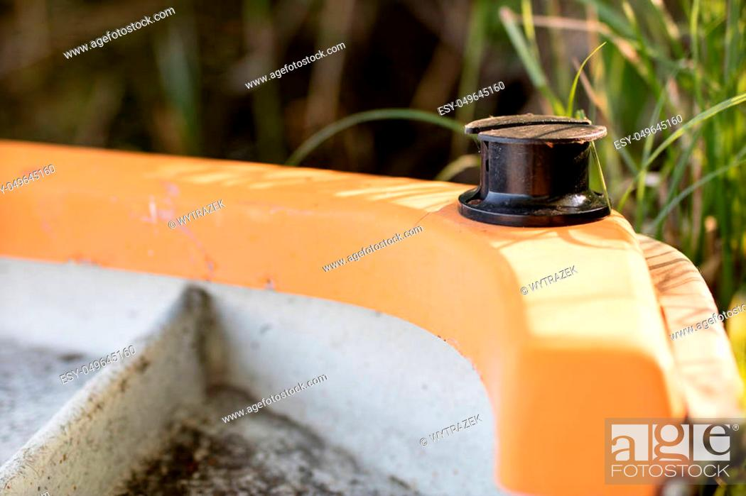 Stock Photo: Capstan on a small sailing boat. Equipment for a sailing boat floating in inland waters. Season of the spring.