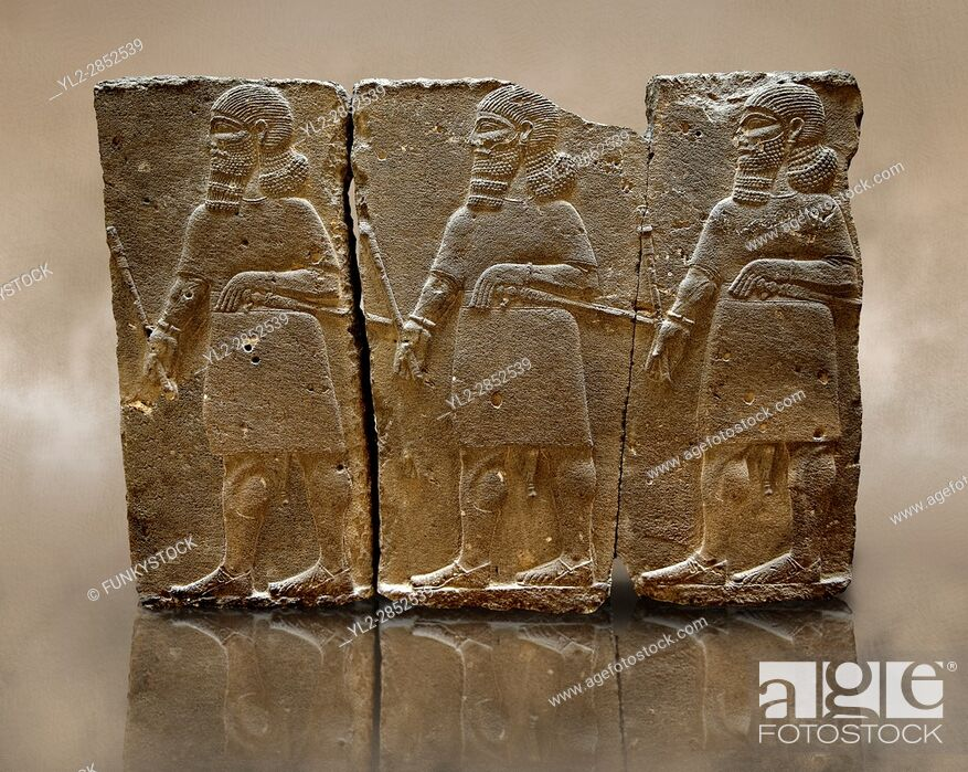 Stock Photo: Sculpted Assyrian relief panels of mace bearers from Hadatu ( Aslantas ) around 800 B. C. Istanbul Archaeological museum Inv No. 14-10.