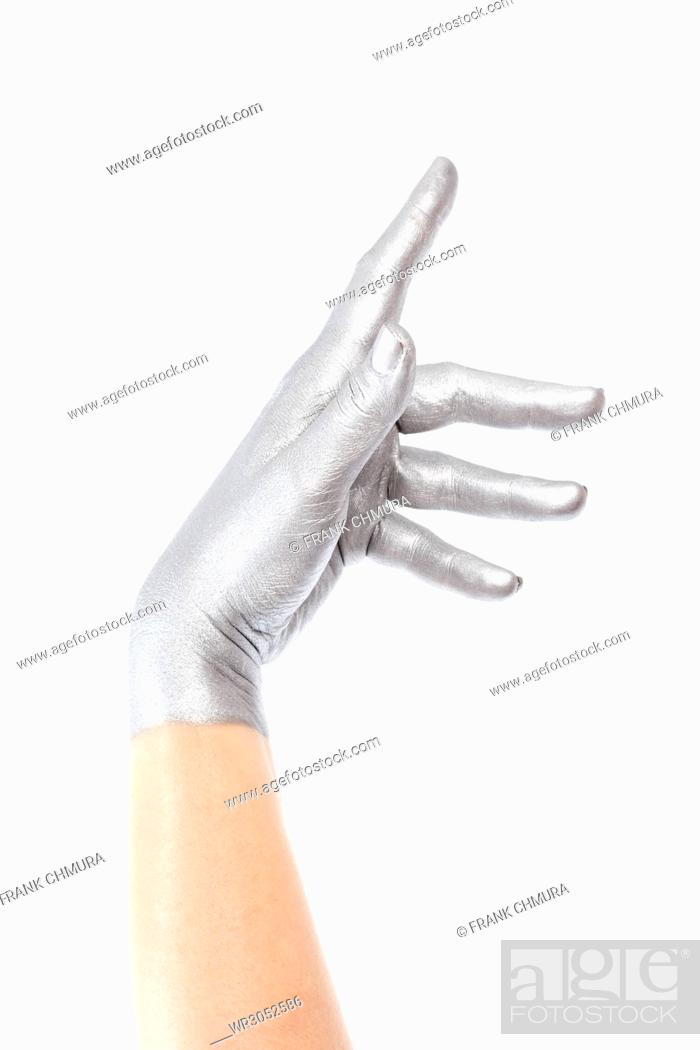 Stock Photo: Hand with Silver Colour on Making Gestures.