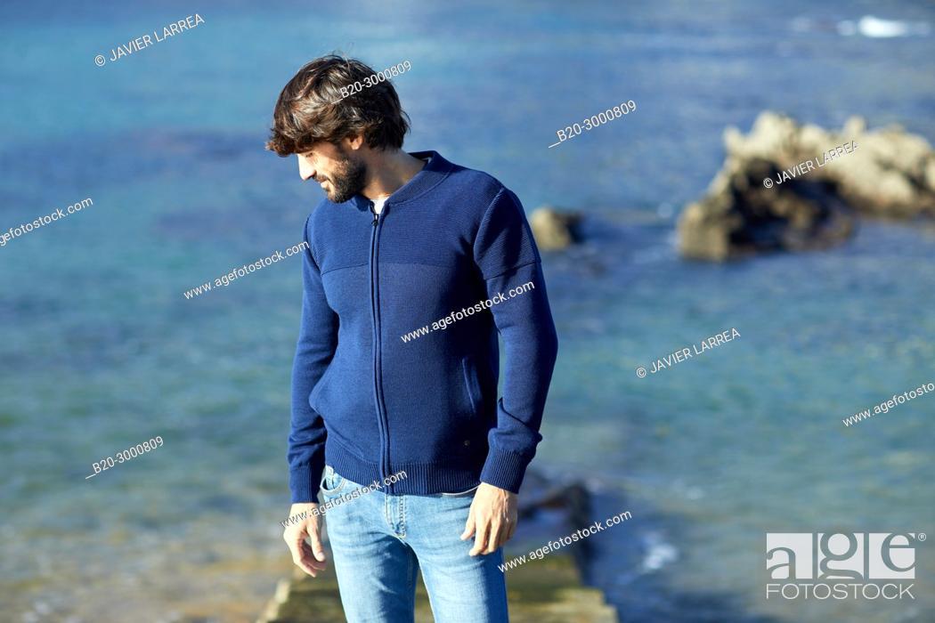 Stock Photo: Adult man at the coast of Santa Clara Island, Donostia, San Sebastian, Gipuzkoa, Basque Country, Spain, Europe.