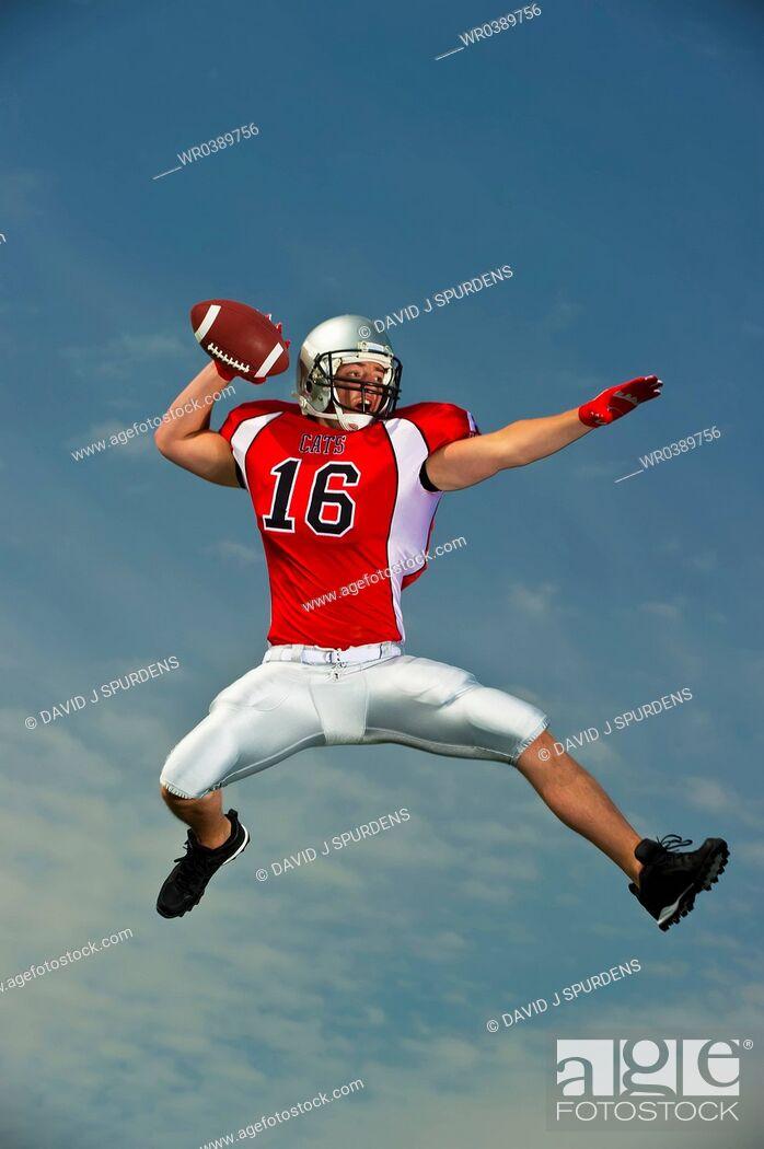 Stock Photo: Quarterback making pass.