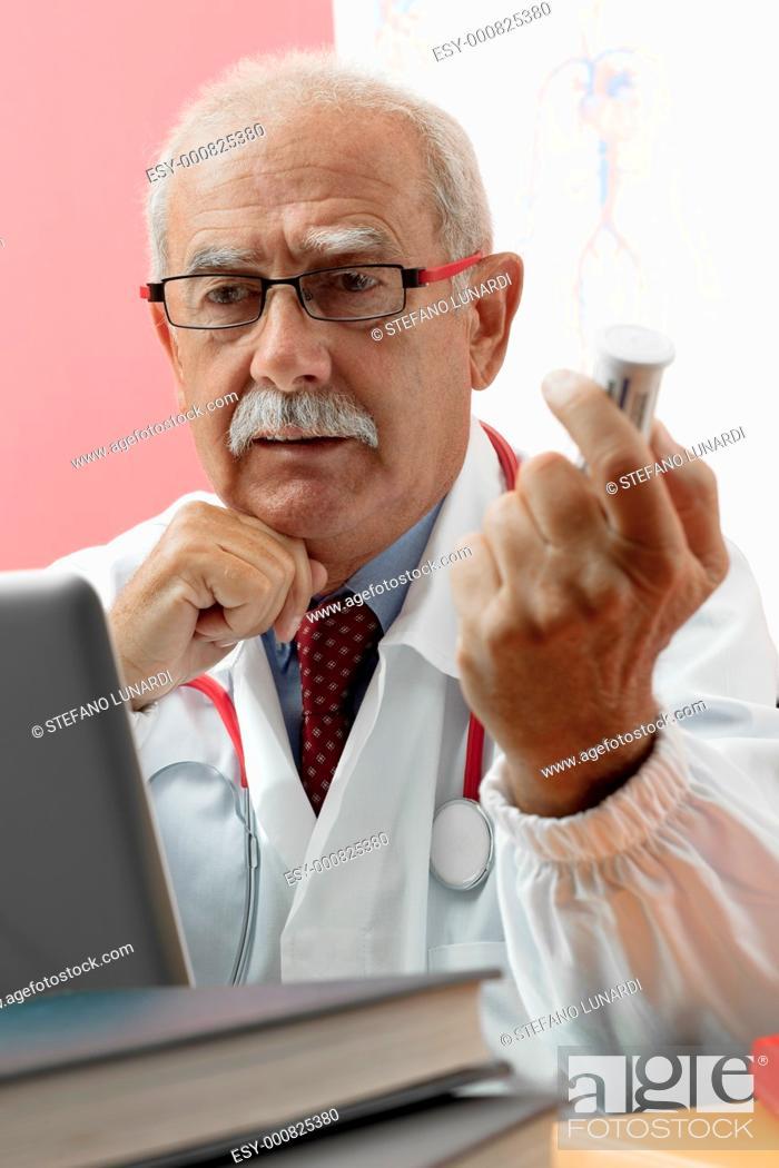 Stock Photo: Senior doctor speaking with patient through webcam.