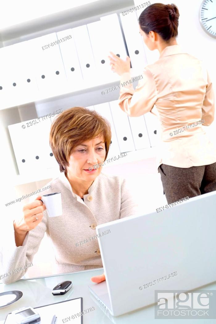 Stock Photo: Businesswoman and assistant.
