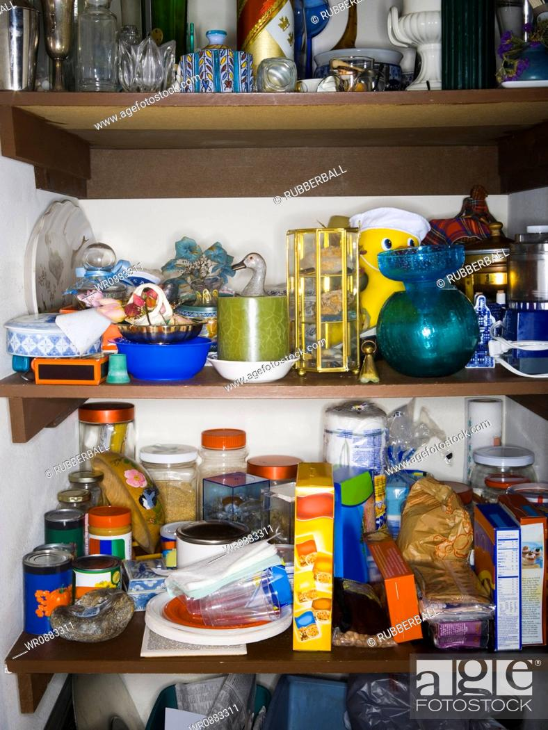 Stock Photo: Close-up of goods on shelves in a pantry.
