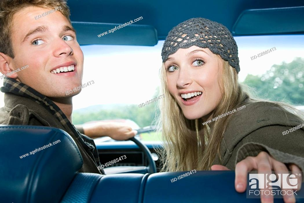 Stock Photo: Young couple in car.