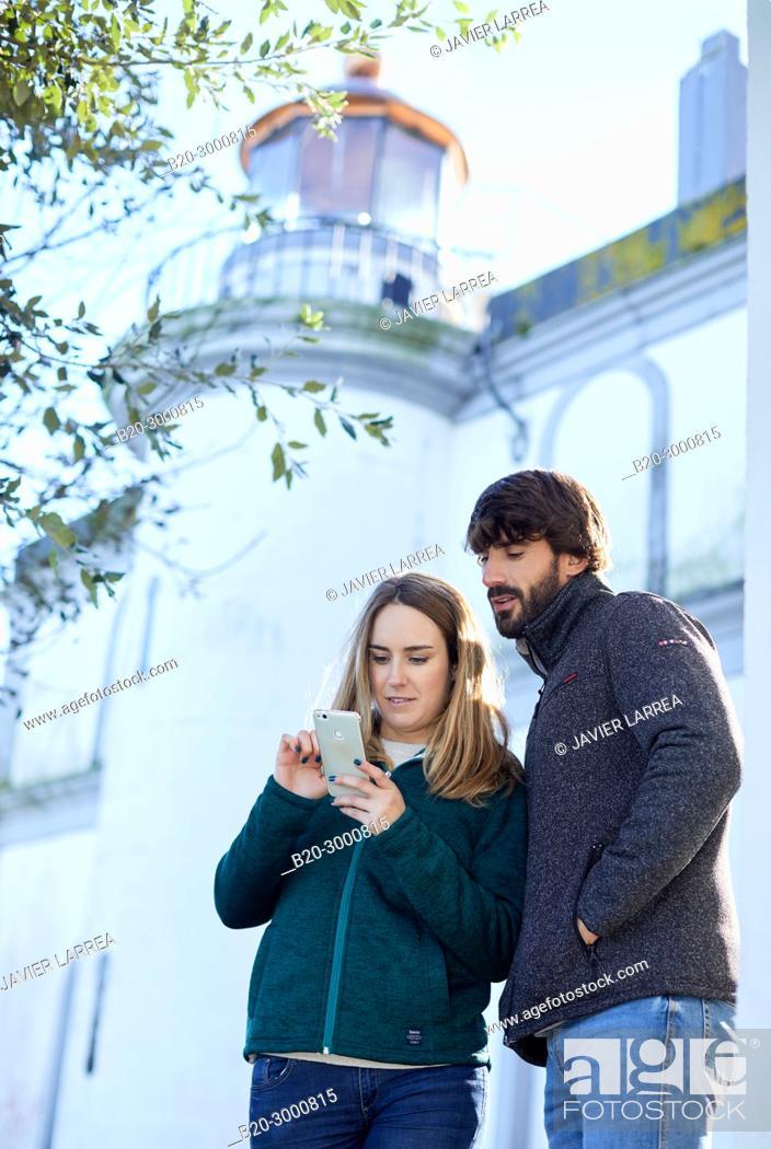 Stock Photo: Couple, Lighthouse of Santa Clara Island, Donostia, San Sebastian, Gipuzkoa, Basque Country, Spain, Europe, Winter.