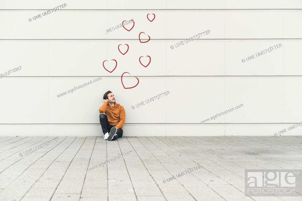 Stock Photo: Digital composite of young man at a wall.