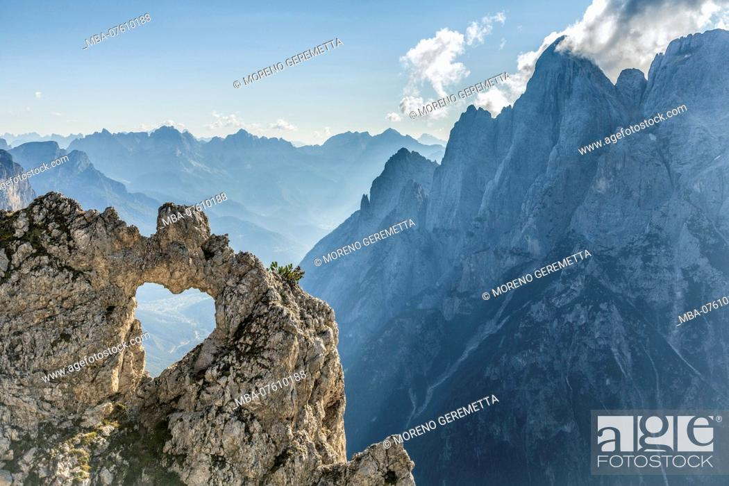 Stock Photo: Europe, Italy, Veneto, Belluno, Agordino. The heart of rock, a natural hole in the shape of a heart, Pala group, Dolomites.