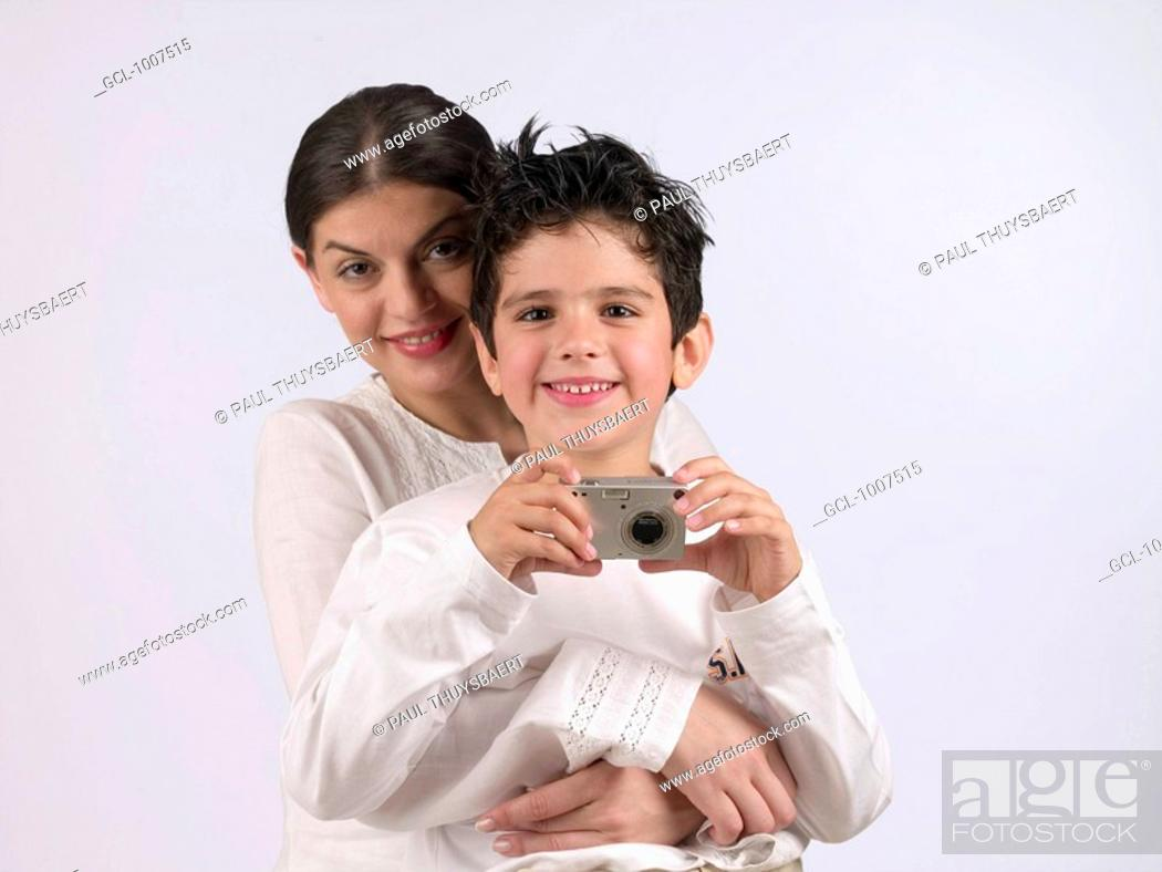 Stock Photo: Mother with son holding a camera.