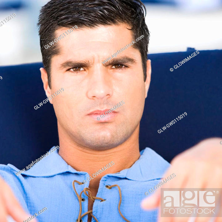 Stock Photo: Portrait of a mid adult man looking serious.