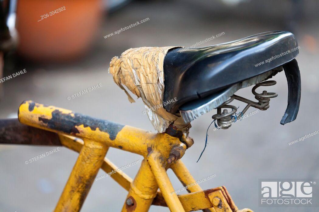 Stock Photo: Old Rickshaw Saddle in Phnom Penh, Cambodia.