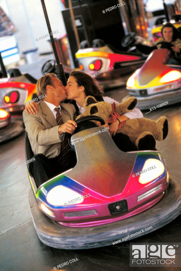 Stock Photo: Couple kissing in bumper cars.