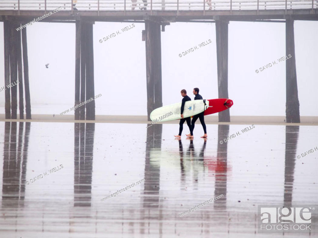 Stock Photo: Surfers with boards in Pismo Beach, California, USA.