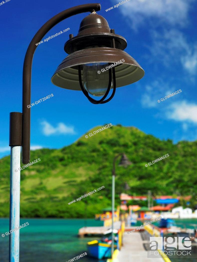 Stock Photo: Close-up of a lamppost with mountains in the background, Lovebird's Bridge, Providencia, Providencia y Santa Catalina, San Andres y Providencia Department.