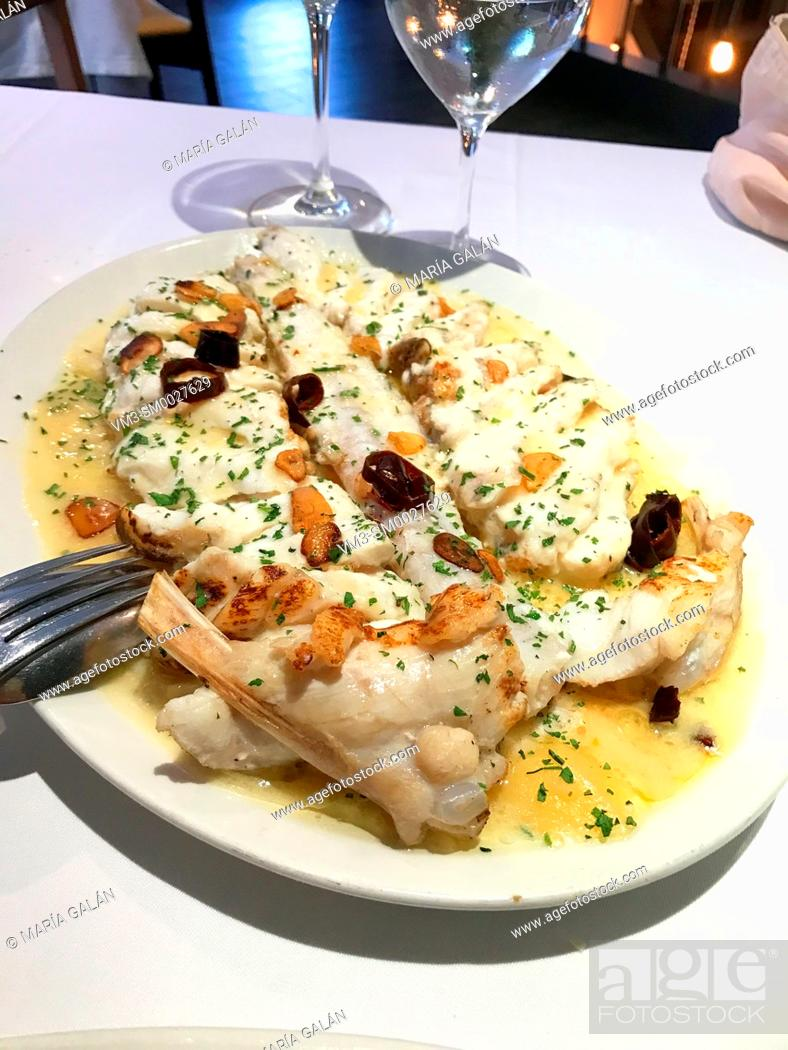 Stock Photo: Grilled monkfish with garlic and olive oil. Spain.