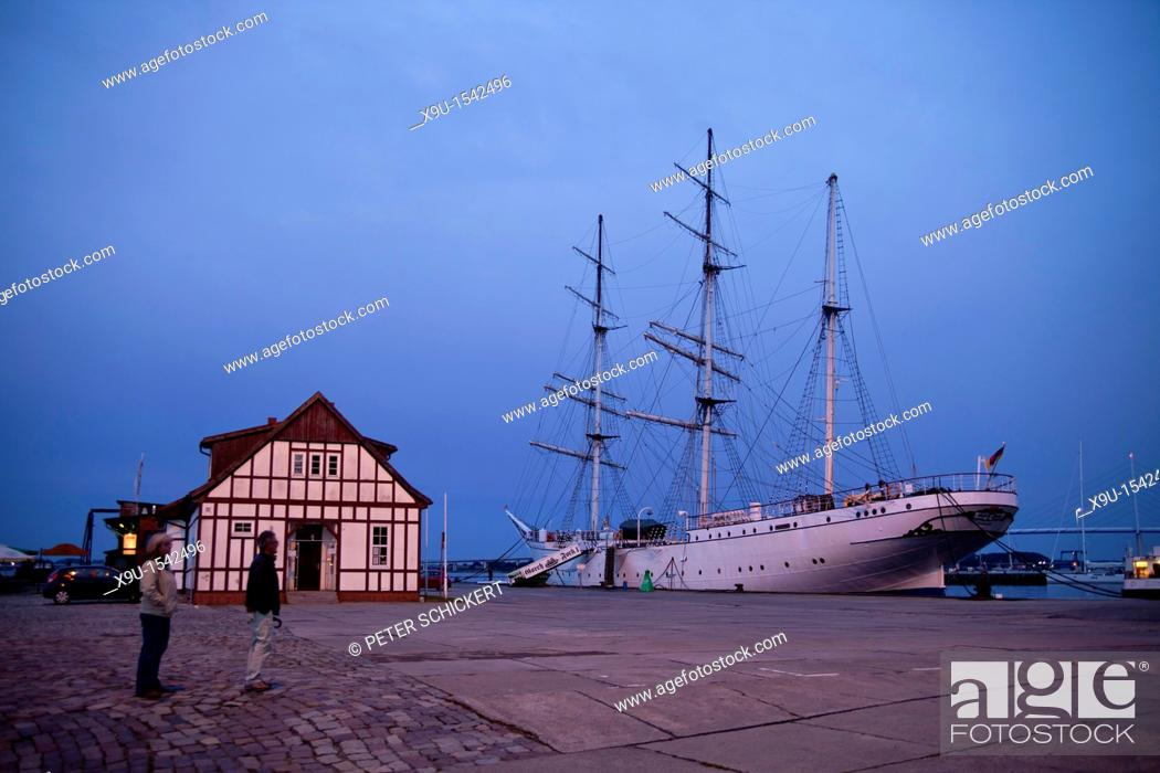 Stock Photo: sunset over the harbor and the three-mast barque Gorch Fock 1 in the Hanseatic City of Stralsund, Mecklenburg-Vorpommern, Germany.