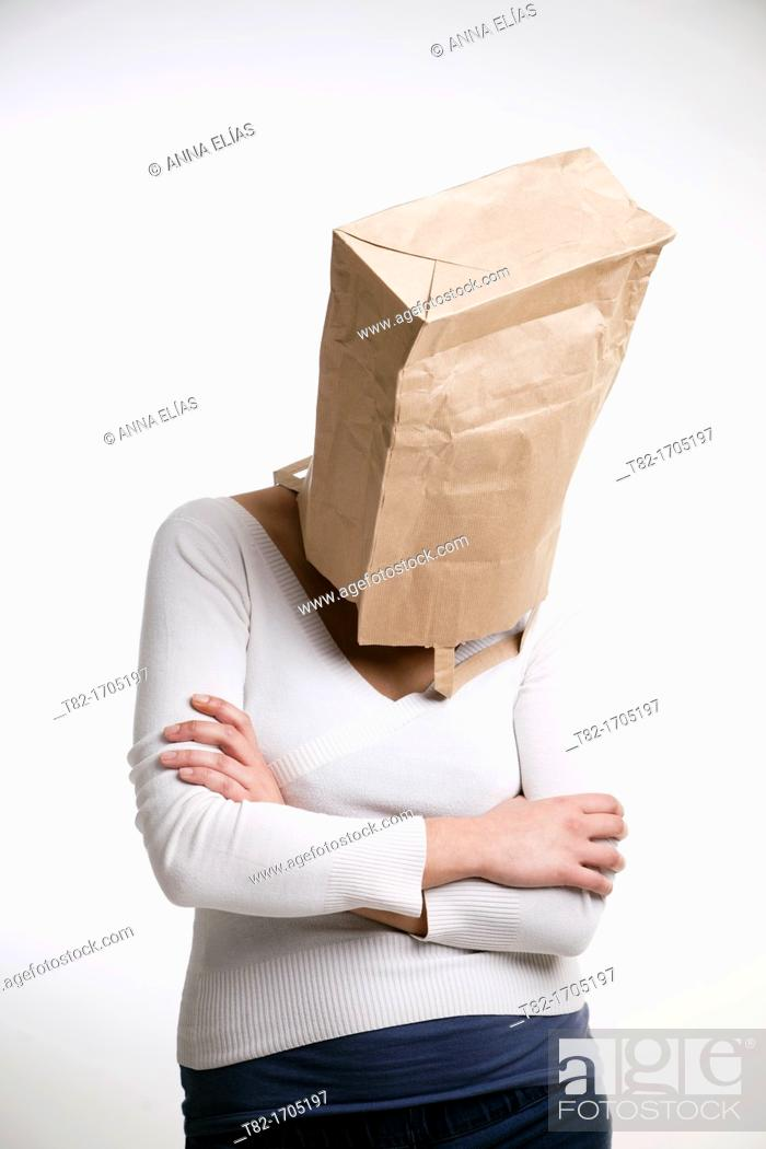 Stock Photo: Woman with bag in head.