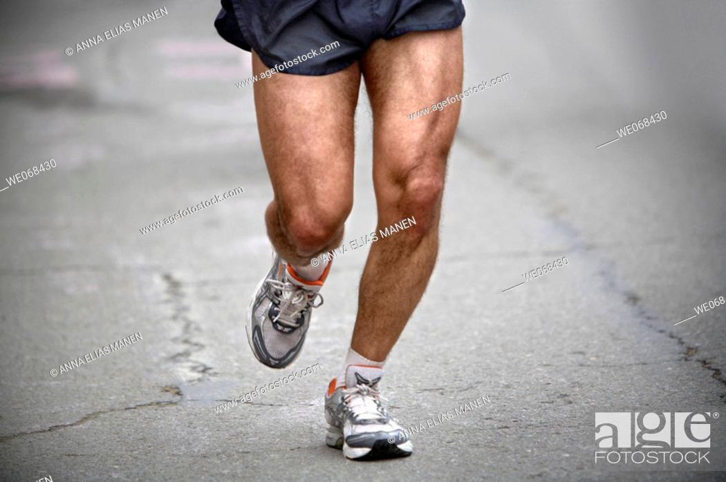Stock Photo: Runner during marathon race.