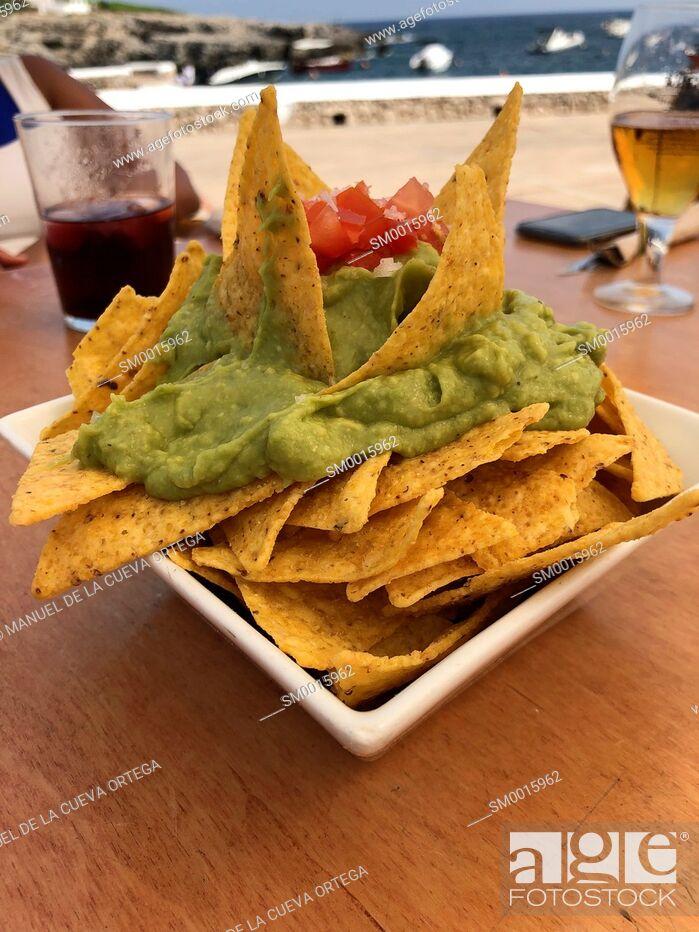 Stock Photo: Nachos with guacamole at Paupa Bar Restaurant, Binibequer, Menorca, Balearic Islands, Spain.