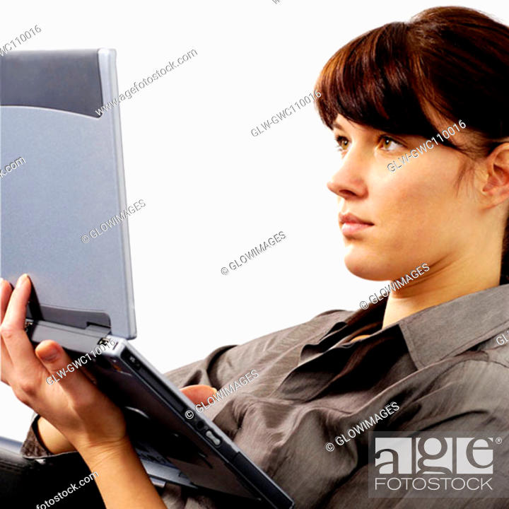 Stock Photo: Close-up of a businesswoman working on a laptop.