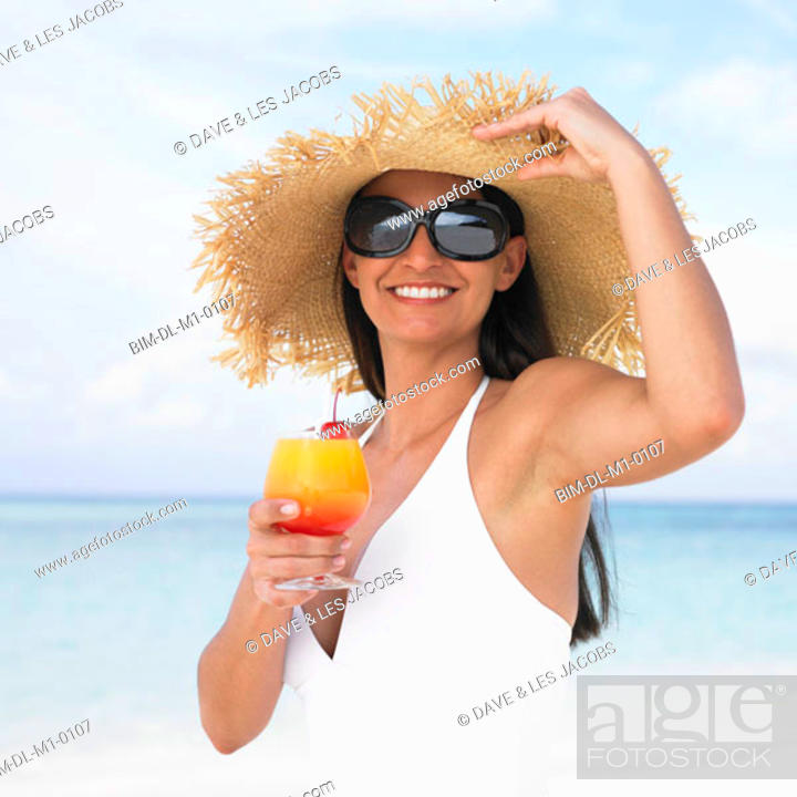 Stock Photo: Woman having tropical drink at the beach.