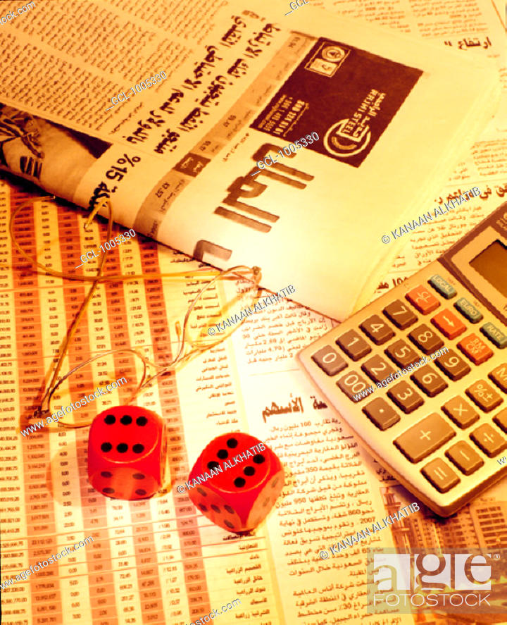 Stock Photo: Arab newspaper, dices and calculator.