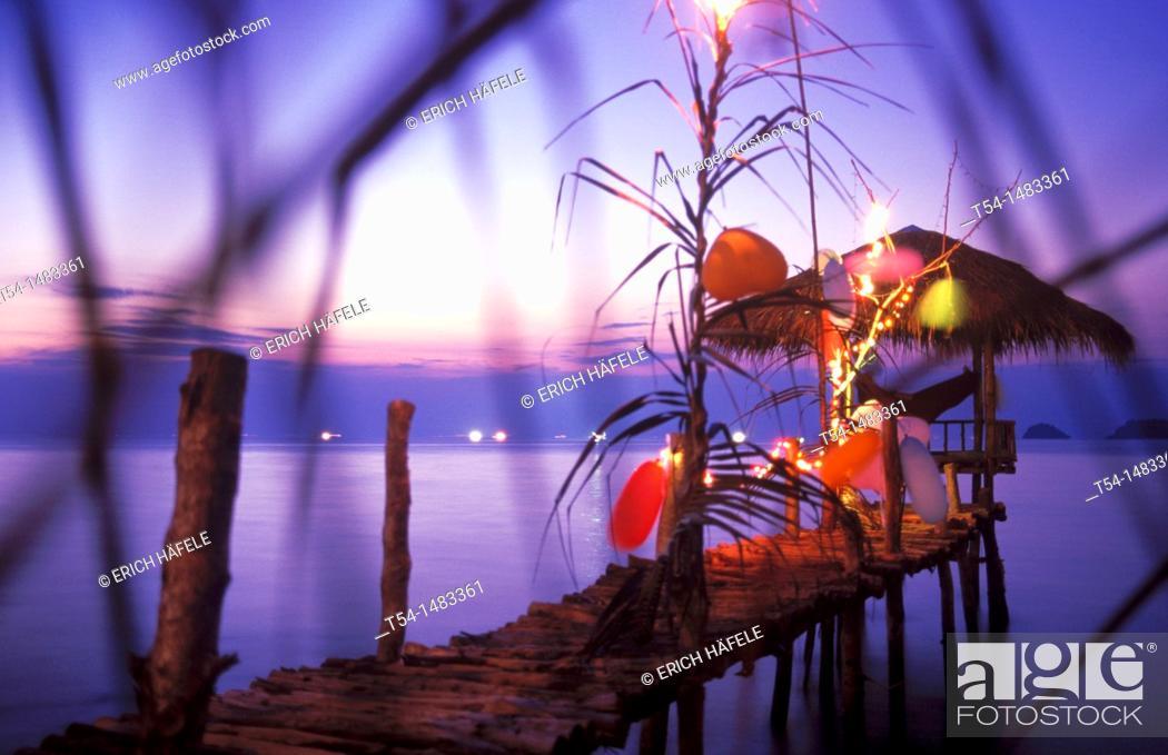 Stock Photo: Colorfully illuminated bar with a small Pavilion at sea on Ko Chang.