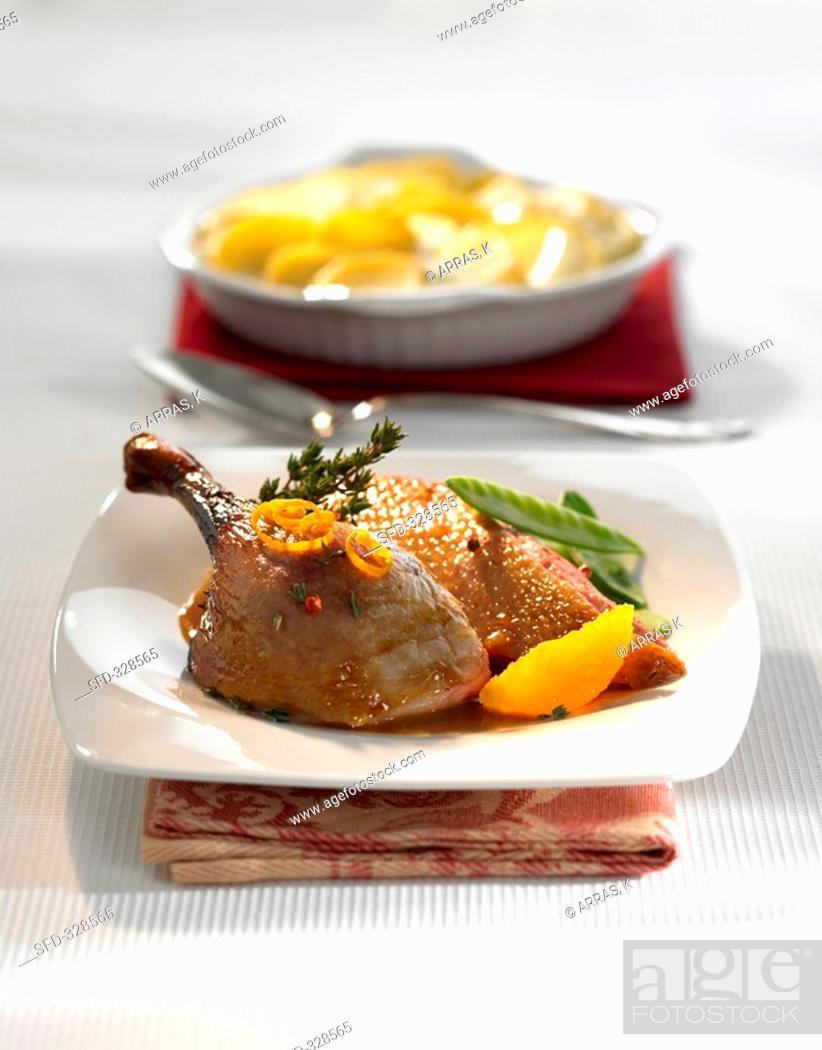 Stock Photo: Duck à l'orange with potato gratin.