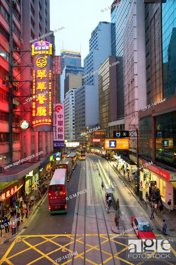 Stock Photo: traffic and pedestrians in downtown Hong Kong, China.