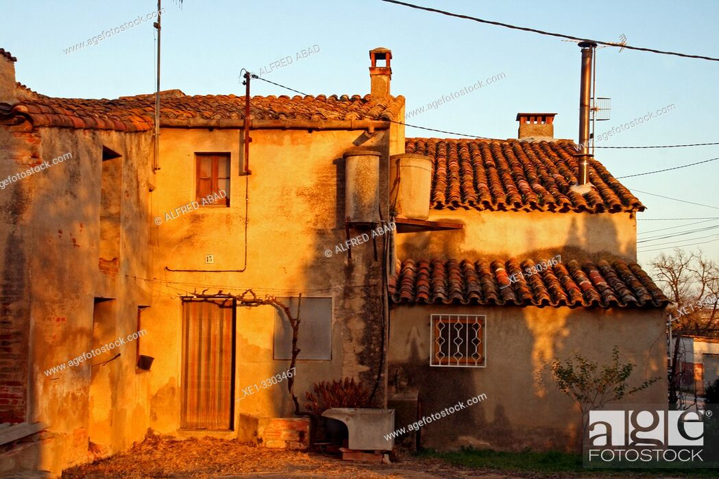 Stock Photo: houses with water tanks at sunset, Tordera, Catalonia, Spain.